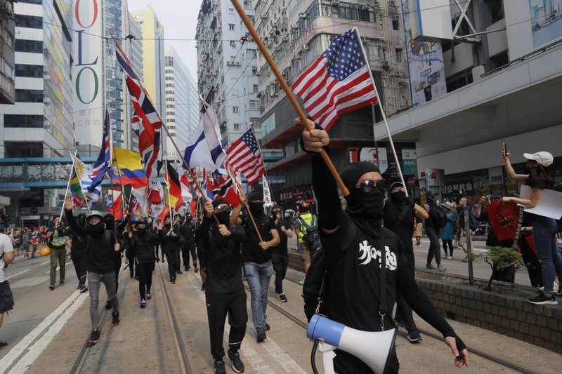 Protestors wave various national flags in Hong Kong on Sunday, Sept. 29, 2019. Sunday's gathering of protesters, a continuation of monthslong protests for greater democracy, is part of global