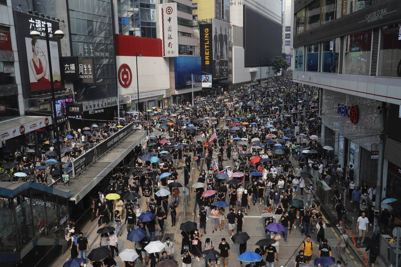 Protesters march in Hong Kong  Sunday, Sept. 29, 2019. Sunday's gathering of protesters, a continuation of months-long protests for greater democracy, is part of global