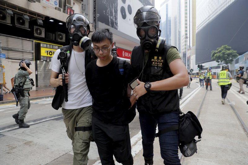 Hong Kong police arrest a protester in Hong Kong on Sunday, Sept. 29, 2019. Sunday's gathering of protesters, a continuation of monthslong protests for greater democracy, is part of global