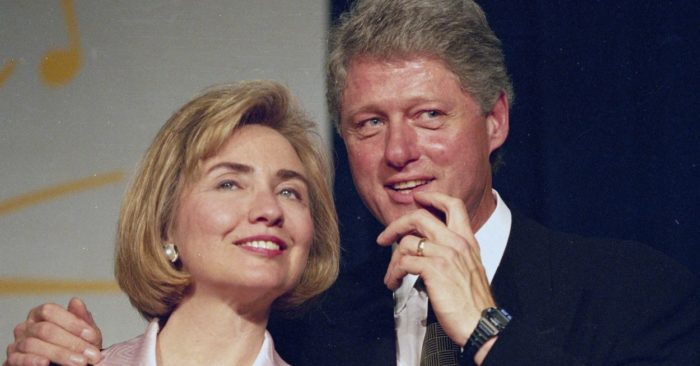 In this June 22, 1994 photo, President Bill Clinton and First Lady Hillary Clinton wait to address a group of young Democratic sympathizers known as the Saxophone Club in Washington. (AP / J. Scott Applewhite)