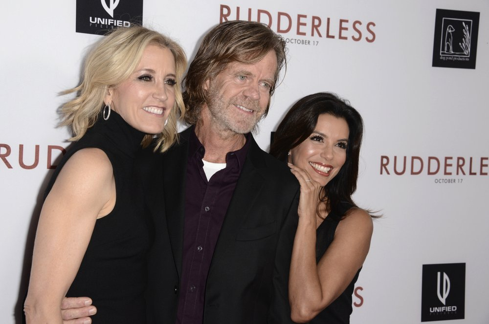"Felicity Huffman, left, writer/director William H. Macy and Eva Longoria arrive at the Los Angeles VIP screening of ""Rudderless"" at the Vista Theater in 2014. (Dan Steinberg / Invision / AP, File)"