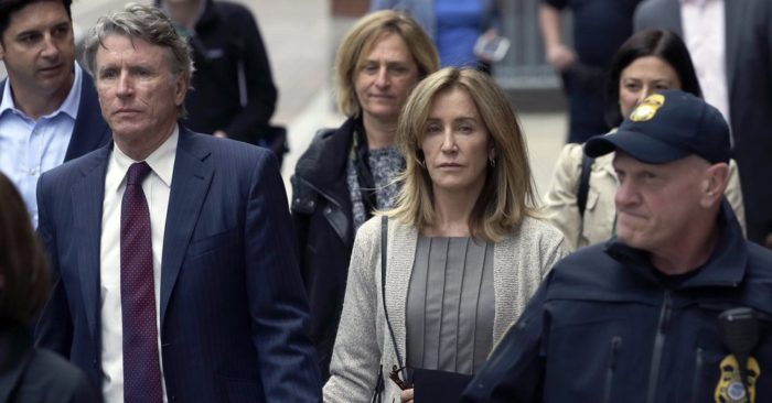 Felicity Huffman (center) leaves federal court with her brother Moore Huffman Jr. on May 13, 2019, in Boston. (AP / Steven Senne)