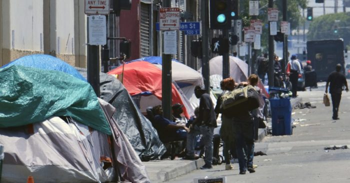 In this May 30, 2019 photo, tents housing homeless people line a street in downtown Los Angeles. (Photo AP/Richard Vogel)