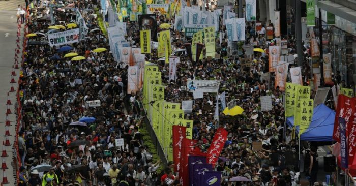 Thousands of demonstrators march along a city street during the annual pro-democracy protest in Hong Kong on Saturday, July 1, 2017.(Photo AP / Vincent Yu)