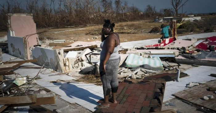 A woman is overwhelmed to see her home destroyed by Hurricane Dorian in High Rock, Grand Bahama, Bahamas, on Sept. 6, 2019. (AP/Ramon Espinosa)