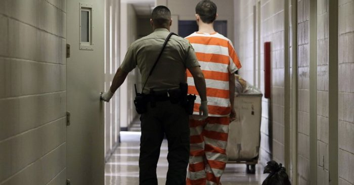 A Madera County Jail inmate is taken to a housing unit at Madera's facility in California, Feb. 21, 2013. (AP/Rich Pedroncelli, File)