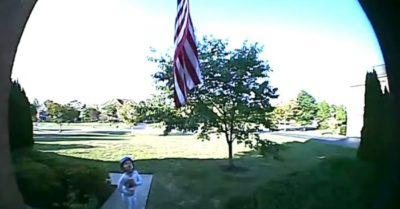 5-year-old boy stands in front of the US flag and recites the Pledge of Allegiance in adorable footage