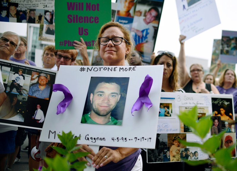 Protest from people who have lost loved ones to OxyContin and opiate overdose (Photo AP/Jessica Hill, Fli)