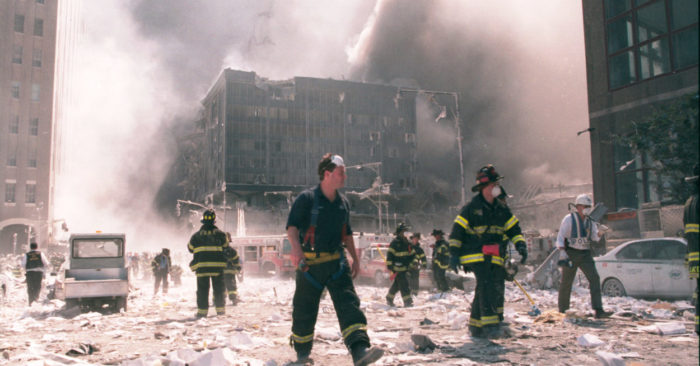 NEW YORK – SEPT. 11: New York City firefighters work near the area known as Ground Zero on Sept. 11, 2001 in New York City. (Anthony Correia / Shutterstock).