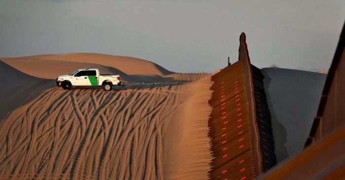 In this July 18, 2018 photograph, a Border Patrol agent monitors the border with Mexico in Imperial County, California. (AP Photo/Matt York, file)