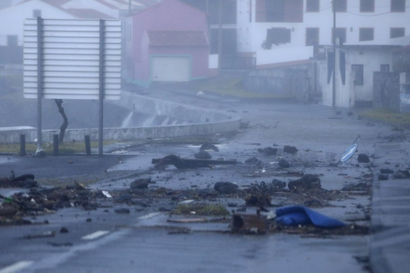 Debris driven by wind and crashing waves lies on a seafront road in Horta, in the Portuguese island of Faial, Wednesday, Oct. 2, 2019. Hurricane Lorenzo is lashing the mid-Atlantic Azores Islands with heavy rain, powerful winds and high waves. The Category 2 hurricane passed the Portuguese island chain Wednesday. (AP Photo/Joao Henriques)