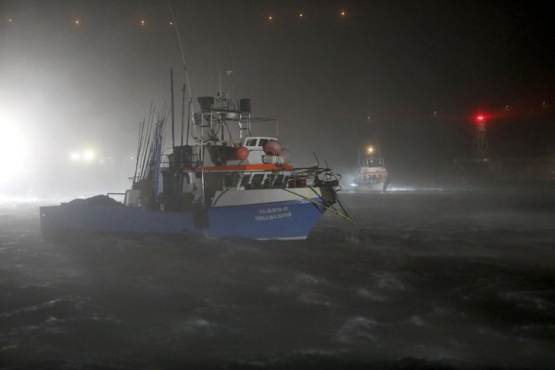 Fishing boats rock under heavy rain and strong winds at the port in Horta, in the Portuguese island of Faial, Wednesday, Oct. 2, 2019. Hurricane Lorenzo is lashing the mid-Atlantic Azores Islands with heavy rain, powerful winds and high waves. The Category 2 hurricane passed the Portuguese island chain Wednesday. (AP Photo/Joao Henriques)