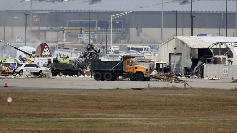 A fire-and-rescue operation is underway where World War II-era bomber plane crashed at Bradley International Airport in Windsor Locks, Conn., Wednesday, Oct. 2, 2019. A fire with black smoke rose from near the airport as emergency crews responded. The airport said in a message on Twitter that it has closed. (AP Photo/Jessica Hill)