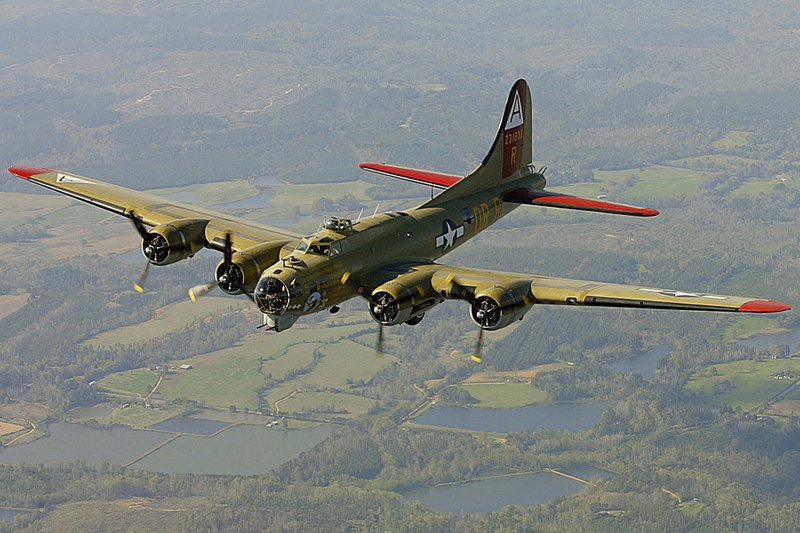 FILE - In this April 2, 2002, file photo, the Nine-O-Nine, a Collings Foundation B-17 Flying Fortress, flies over Thomasville, Ala., during its journey from Decatur, Ala., to Mobile, Ala. A B-17 vintage World War II-era bomber plane crashed Wednesday, Oct. 2, 2019,  just outside New England's second-busiest airport, and a fire-and-rescue operation was underway, official said. Airport officials said the plane was associated with the Collings Foundation, an educational group that brought its