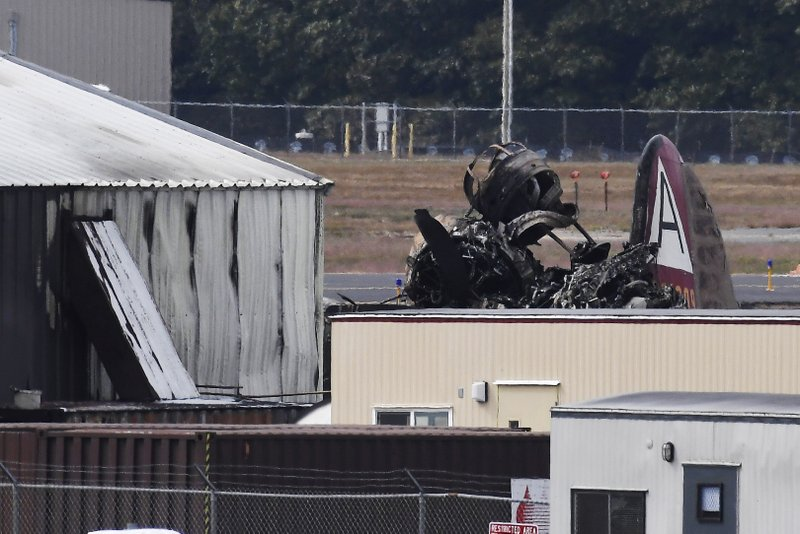 Wreckage is seen where World War II-era bomber plane crashed at Bradley International Airport in Windsor Locks, Conn., Wednesday, Oct. 2, 2019. A fire with black smoke rose from near the airport as emergency crews responded. The airport said in a message on Twitter that it has closed. (AP Photo/Jessica Hill)