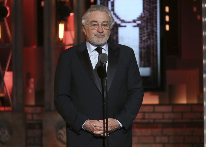 FILE - This June 10, 2018 file photo shows Robert De Niro introducing a performance by Bruce Springsteen at the 72nd annual Tony Awards in New York. De Niro is being sued by his former assistant who claims he subjected her to sexist and harassing comments. Chase Robinson sued the 76-year-old De Niro Thursday, Oct. 3, in Manhattan federal court, seeking $12 million. The lawsuit came six weeks after De Niro's company, Canal Productions, sought $6 million from Robinson in state court, accusing her of misappropriating money.  (Photo by Michael Zorn/Invision/AP, File)