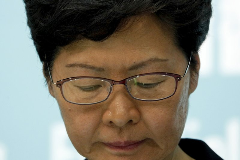Hong Kong Chief Executive Carrie Lam reacts during a press conference in Hong Kong Friday, Oct. 4, 2019. The Hong Kong leader has banned protesters from wearing masks to conceal their identities in a hardening of the government's stance against the four-month-old demonstrations. (AP Photo/Kin Cheung)
