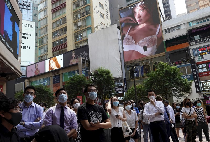 Protesters wear masks against plans for a law against wearing masks in Hong Kong on Friday, Oct. 4, 2019. Hong Kong pro-democracy protesters marched in the city center ahead of reported plans by the city's embattled leader to deploy emergency powers to ban people from wearing masks in a bid to quash four months of anti-government demonstrations. (AP Photo/Vincent Yu)