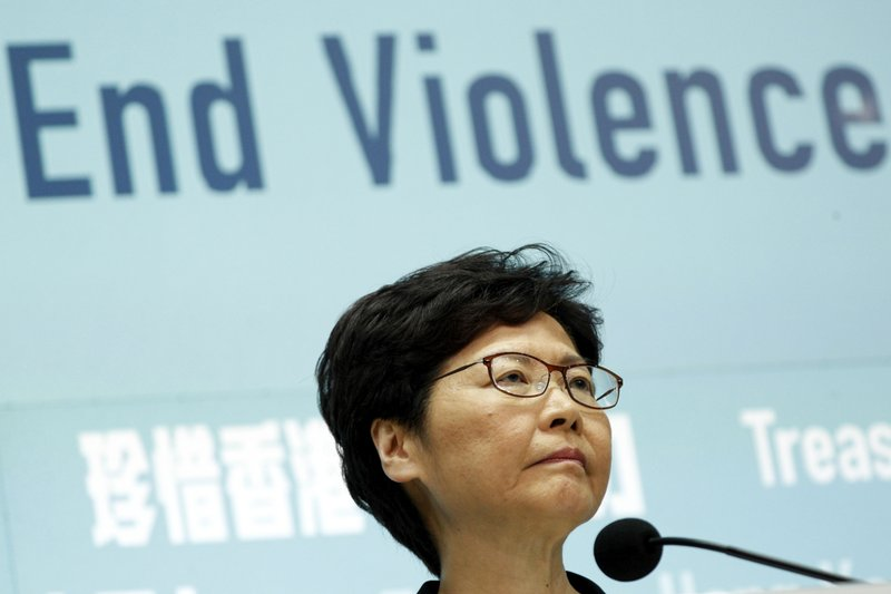 Hong Kong Chief Executive Carrie Lam attends a press conference in Hong Kong Friday, Oct. 4, 2019. The Hong Kong leader has banned protesters from wearing masks to conceal their identities in a hardening of the government's stance against the four-month-old demonstrations. (AP Photo/Kin Cheung)