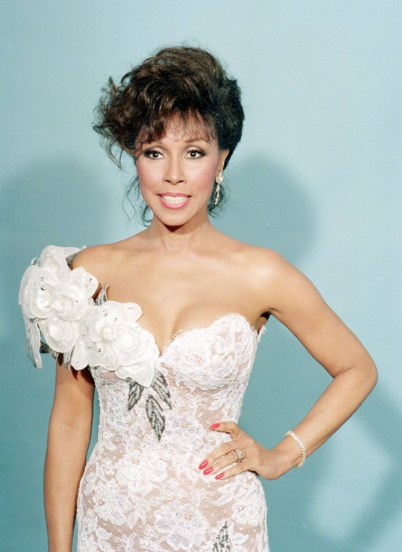 FILE - This Sept. 20, 1987 file photo shows actress Diahann Carroll at the Emmy Awards in Los Angeles. Carroll passed away Friday, Oct. 4, 2019  at her home in Los Angeles after a long bout with cancer.  She was 84. (AP Photo/Douglas Pizac, File)