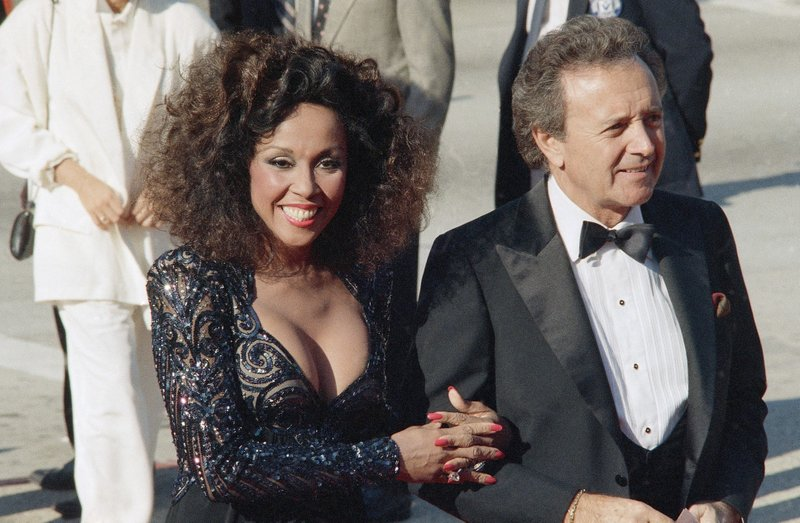 FILE - This Sept. 21, 1986 file photo shows singers Vic Damone, right, and Diahann Carroll at the Emmy awards in Los Angeles. Carroll died, Friday, Oct. 4, 2019, at her home in Los Angeles after a long bout with cancer. She was 84. (AP Photo/Doug Pizac, File)