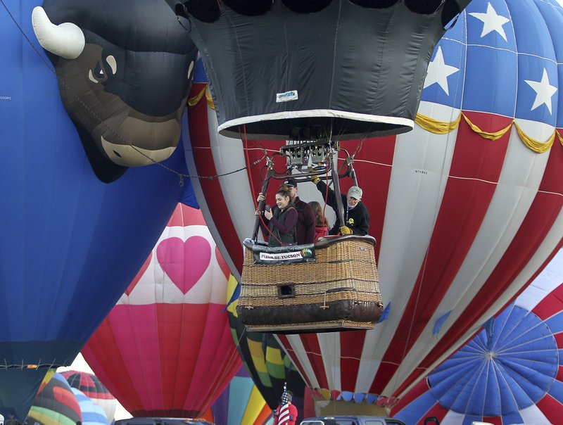 Balloonist prepare for lift-off after being grounded by fog Saturday at the Albuquerque International Balloon Fiesta in Albuquerque, N.M., Sunday, Oct. 6, 2019. (Jerry Larson/Waco Tribune-Herald via AP)