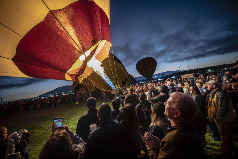 A balloon is inflated at the 2019 Albuquerque International Balloon Fiesta on Saturday, Oct. 5, 2019, in Albuquerque, N.M. The event got off to a rocky start with heavy fog preventing balloonists from launching on the first day of the event. The spectacle has grown over nearly five decades and infuses millions of dollars into the economy each year. (Roberto E. Rosales/The Albuquerque Journal via AP)