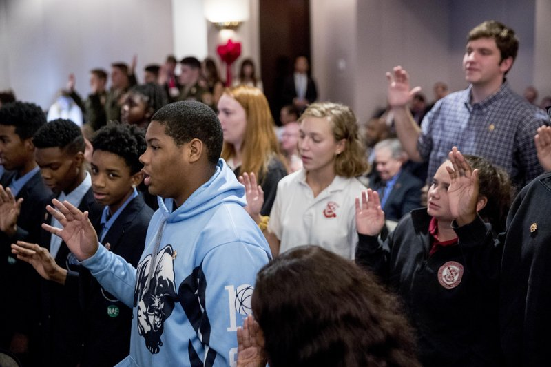 Students in the audience take an anti-drug pledge at a Red Ribbon Rally at the Drug Enforcement Agency in Arlington, Va., Monday, Oct. 7, 2019.(AP Photo/Andrew Harnik)
