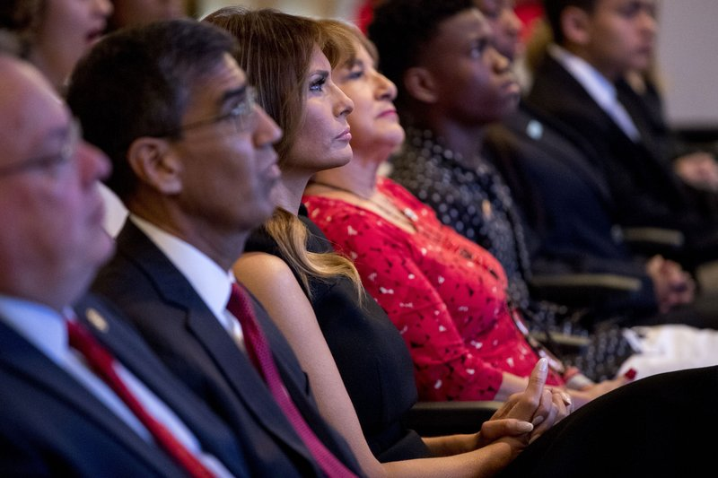 From left, acting DEA Administrator Uttam Dhillon, First lady Melania Trump, and Mika Camarena, the wife of former DEA agent Kiki Camarena who was killed in 1985 while on assignment in Mexico attend a Red Ribbon Rally at the Drug Enforcement Agency in Arlington, Va., Monday, Oct. 7, 2019.(AP Photo/Andrew Harnik)