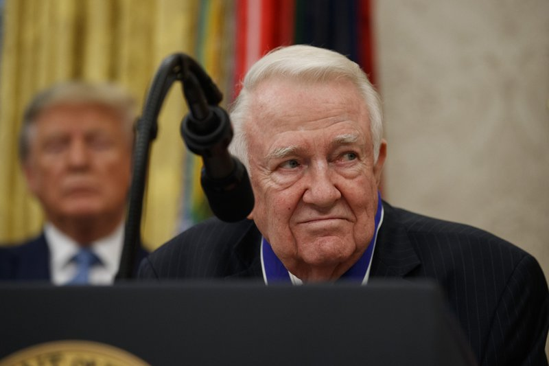 Former Attorney General Edwin Meese speaks, with President Donald Trump behind him, during a ceremony to present the Presidential Medal of Freedom to Meese, in the Oval Office of the White House, Tuesday, Oct. 8, 2019, in Washington. (AP Photo/Alex Brandon)