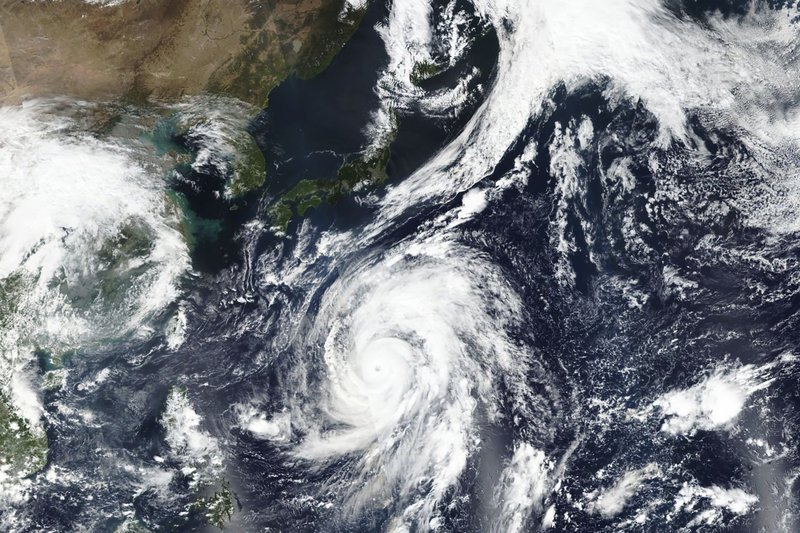 This Oct. 9, 2019, satellite photo taken by NASA-NOAA's Suomi NPP satellite shows typhoon Hagibis approaching Japan, top.  Japan's weather agency is warning a powerful typhoon may bring torrential rains to central Japan over the weekend. (NASA Worldview, Earth Observing System Data and Information System (EOSDIS) via AP)