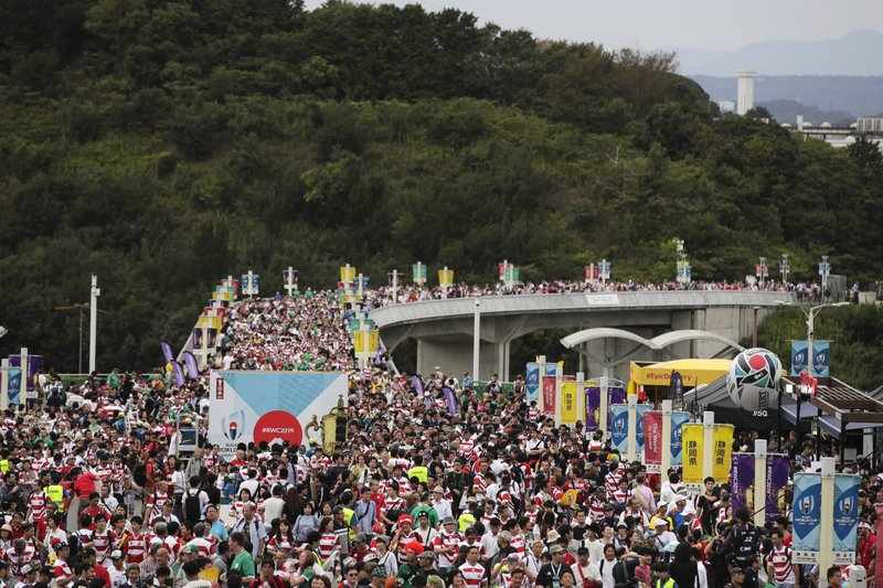 In this Sept. 28, 2019, file photo, a sea of people arrive at Shizuoka Stadium Ecopa for the Rugby World Cup Pool A game between Japan and Ireland in Shizuoka, Japan. Rugby World Cup organizers have had to cancel two games scheduled for Saturday because of concerns over the anticipated impact of Typhoon Hagibis.(AP Photo/Jae C. Hong, File)