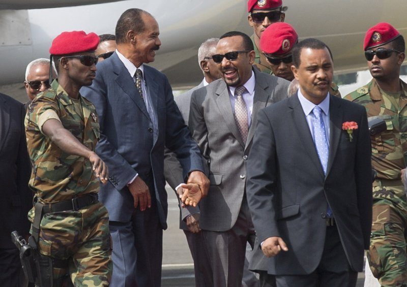 FILE - In this Saturday, July 14, 2018 file photo, Eritrean President Isaias Afwerki, center left, is welcomed by Ethiopia's Prime Minister Abiy Ahmed, center right, upon his arrival at Addis Ababa International Airport, Ethiopia. Once official rivals, the leaders of Ethiopia and Eritrea have embraced warmly to the roar of a crowd of thousands at a concert celebrating the end of a long state of war. The 2019 Nobel Peace Prize was given to Ethiopian Prime Minister Abiy Ahmed on Friday Oct. 11, 2019. (AP Photo Mulugeta Ayene, File)