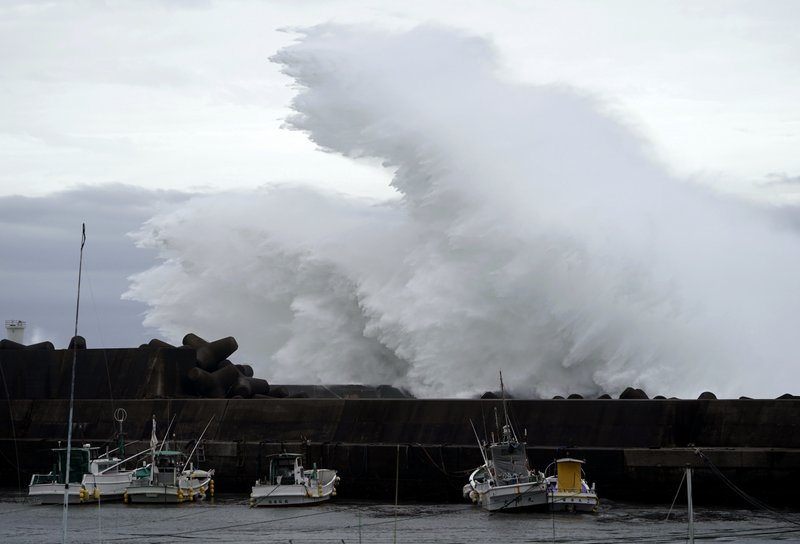 Surging waves hit against the breakwater while Typhoon Hagibis approaches at a port in town of Kiho, Mie prefecture, Japan Friday, Oct. 11, 2019. A powerful typhoon is advancing toward the Tokyo area, where torrential rains are expected this weekend. (AP Photo/Toru Hanai)