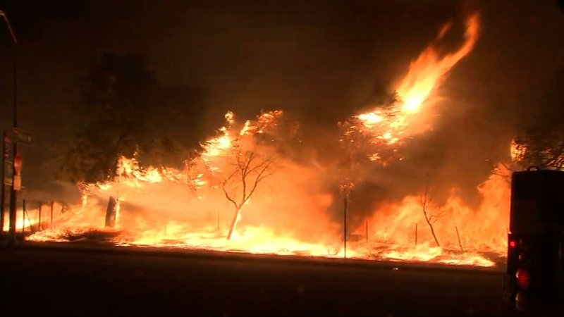 Crews are battling a brush fire that prompted evacuations and closed Interstate 210 in the Sylmar neighborhood of the San Fernando Valley in Los Angeles. Several vehicles burned in a nearby industrial complex. (Oct. 11)