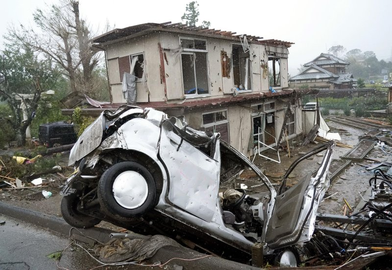 Destroyed house and vehicle are seen following a strong wind in Ichihara, Chiba, near Tokyo Saturday, Oct. 12, 2019. Tokyo and surrounding areas braced for a powerful typhoon forecast as the worst in six decades, with streets and trains stations unusually quiet Saturday as rain poured over the city. (Katsuya Miyagawa/Kyodo News via AP)