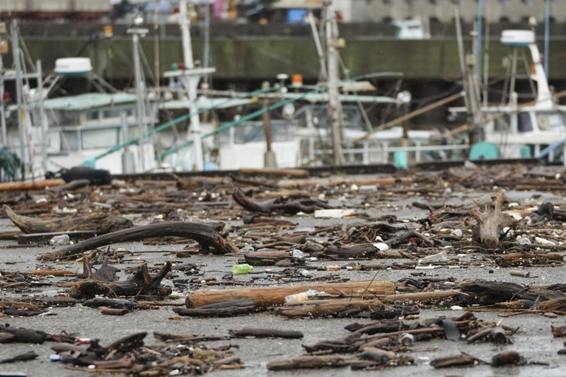 Sea wracks land at a port as Typhoon Hagibis approaches in town of Kiho, Mie prefecture, central Japan Saturday, Oct. 12, 2019. Tokyo and surrounding areas braced for a powerful typhoon forecast as the worst in six decades, with streets and trains stations unusually quiet Saturday as rain poured over the city. (AP Photo/Toru Hanai)