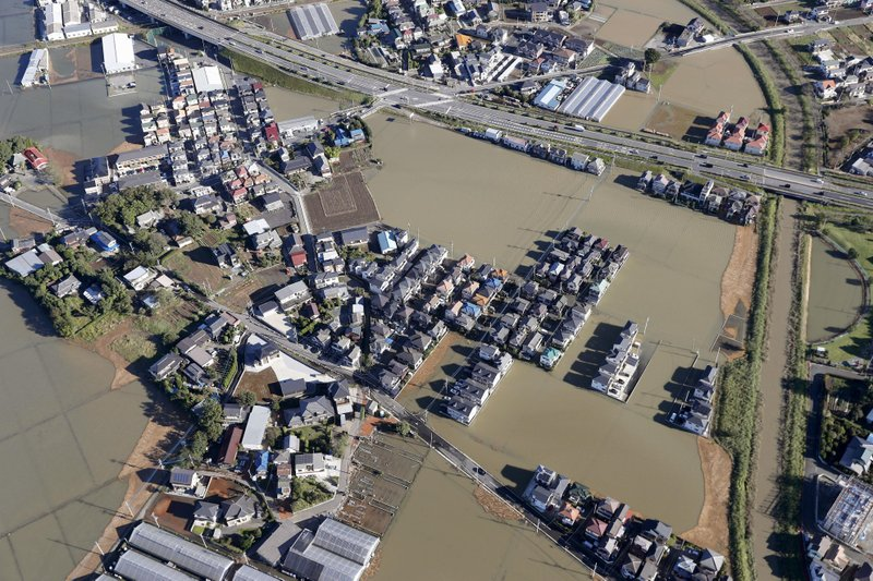 Houses are submerged in muddy waters as Typhoon Hagibis hit the area, in Kawagoe, north of Tokyo, Sunday, Oct. 13, 2019. Rescue efforts for people stranded in flooded areas are in full force after a powerful typhoon dashed heavy rainfall and winds through a widespread area of Japan, including Tokyo.(Takuya Inaba/Kyodo News via AP)