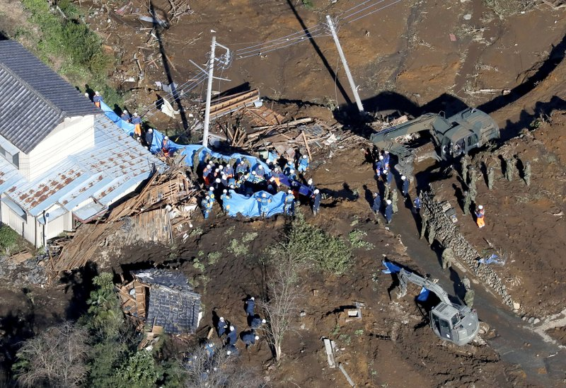 Rescuers work at a landslide site hit by Typhoon Hagibis, in Tomioka, north of Tokyo, Sunday, Oct. 13, 2019. Rescue efforts for people stranded in flooded areas are in full force after a powerful typhoon dashed heavy rainfall and winds through a widespread area of Japan, including Tokyo.(Yohei Kanasahi/Kyodo News via AP)
