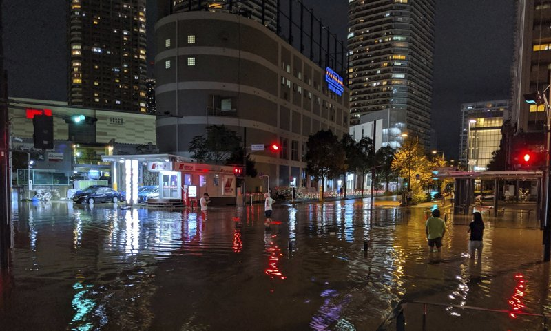 This Oct. 12, 2019 photo by @ar_kaz shows the flooded streets in Kawasaki, near Tokyo, Japan. Helicopters plucked people from their flooded homes on Sunday as rescue efforts went into full force in wide areas of Japan, including Tokyo, after a powerful typhoon unleashed heavy rainfall. (@ar_kaz via AP)