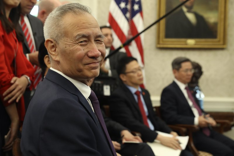 Chinese Vice Premier Liu He listens during a meeting in the Oval Office of the White House with President Donald Trump in Washington, Friday, Oct. 11, 2019. (AP Photo/Andrew Harnik)