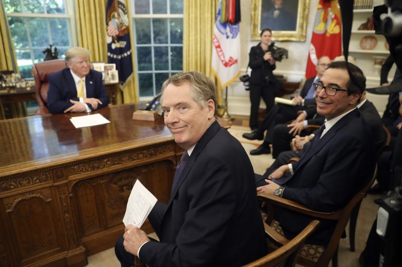U.S. Trade Representative Robert Lighthizer and Treasury Secretary Steven Mnuchin, right, smile as they attend a meeting with President Donald Trump and Chinese Vice Premier Liu He in the Oval Office of the White House in Washington, Friday, Oct. 11, 2019. (AP Photo/Andrew Harnik)