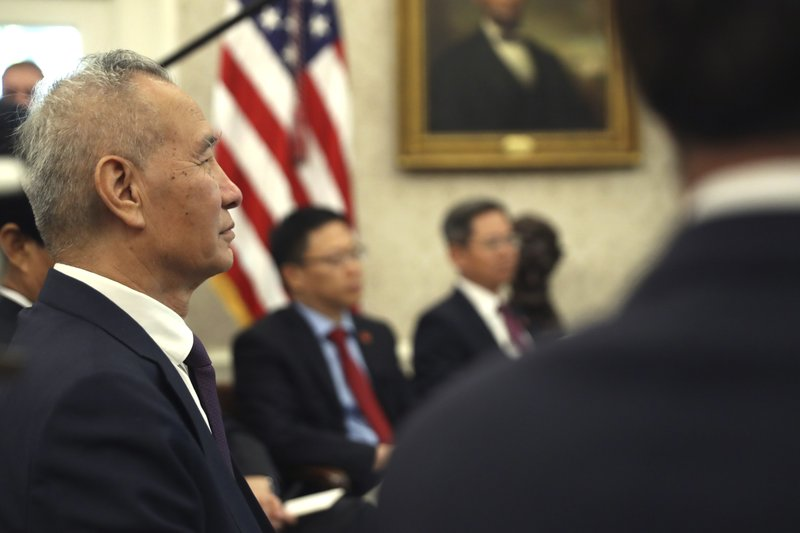 Chinese Vice Premier Liu He listens during a meeting with President Donald Trump in the Oval Office of the White House in Washington, Friday, Oct. 11, 2019. (AP Photo/Andrew Harnik)