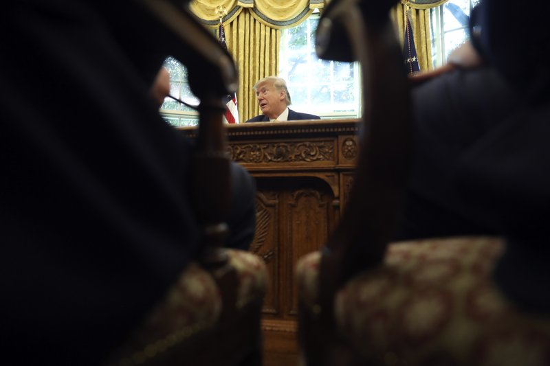 President Donald Trump listens as he meets with Chinese Vice Premier Liu He in the Oval Office of the White House in Washington, Friday, Oct. 11, 2019. (AP Photo/Andrew Harnik)