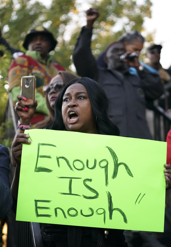 Carol Harrison-Lafayette protests the police shooting of Atatiana Jefferson during a community vigil for Jefferson on Sunday, Oct. 13, 2019, in Fort Worth, Texas. A white police officer who killed the black woman inside her Texas home while responding to a neighbor's call about an open front door