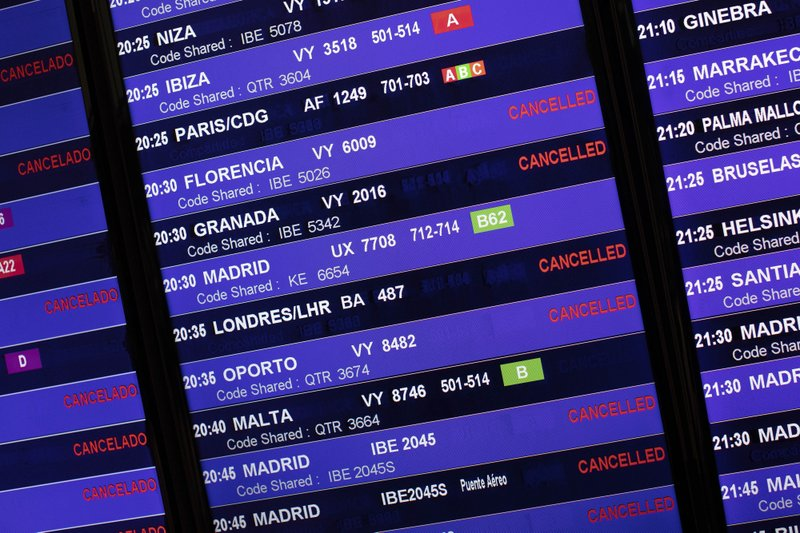 Information panel shows canceled flights at El Prat airport, outskirts of Barcelona, Spain, Monday, Oct. 14, 2019. Spain's Supreme Court on Monday sentenced 12 prominent former Catalan politicians and activists to lengthly prison terms for their roles in a 2017 bid to gain Catalonia's independence, sparking protests across the wealthy Spanish region. (AP Photo/Bernat Armangue)