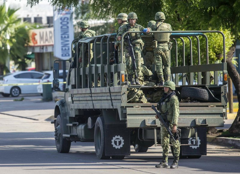 Mexican soldiers patrol around the city a day after a gun battle between gunmen and security forces in Culiacan, Mexico, on Friday Oct. 18, 2019. Mexican security forces backed off an attempt to capture a son of imprisoned drug lord Joaquin