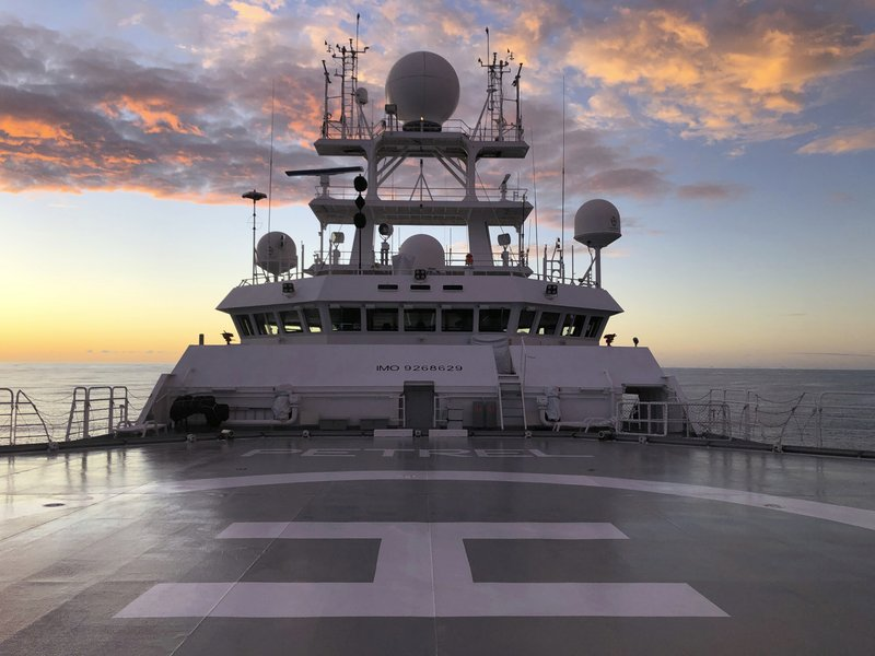 The sun rises over Vulcan Inc.'s research vessel Petrel nearly 200 miles off Midway Atoll in the Northwestern Hawaiian Islands on Friday, Oct. 18, 2019. The crew of the Petrel found the sunken remains of the Japanese aircraft carrier Kaga, which sank in the historic Battle of Midway, and are searching the vast area for other sunken warships in the coming days. (AP Photo/Caleb Jones)