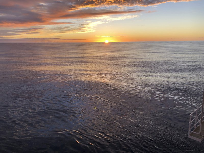 The sun rises over the Pacific from the research vessel Petrel nearly 200 miles off Midway Atoll in the Northwestern Hawaiian Islands on Friday, Oct. 18, 2019. The crew of the Petrel found the sunken remains of the Japanese aircraft carrier Kaga, which sank in the historic Battle of Midway, and are searching the vast area for other sunken warships in the coming days. (AP Photo/Caleb Jones)