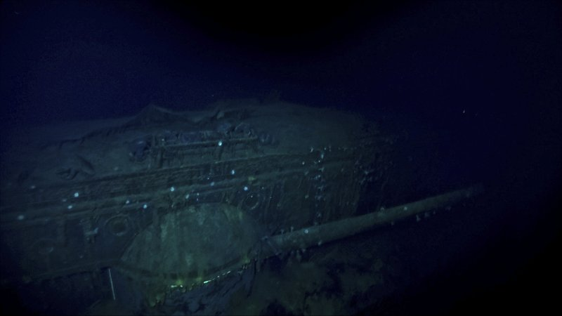 In this Oct. 7, 2019 image taken from underwater video provided by Vulcan Inc., the Japanese aircraft carrier Kaga is shown in the Pacific Ocean off Midway Atoll in the Northwestern Hawaiian Islands. Deep-sea explorers scouring the world's oceans for sunken World War II ships are honing in on a debris field deep in the Pacific. A research vessel called the Petrel is launching underwater robots about halfway between the U.S. and Japan in search of warships from the Battle of Midway. Weeks of grid searches around the Northwestern Hawaiian Islands already have led the Petrel to one sunken battleship, the Kaga. (Vulcan Inc. via AP)